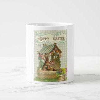 La pintura feliz del conejito de pascua del taza de café grande