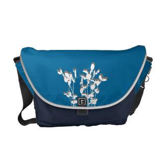 La planta creciente azul de dos tonos sale de la n bolsa messenger