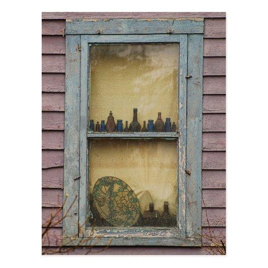 La postal de la ventana de la mujer mayor