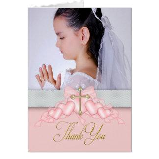 La primera comunión de la foto cruzada rosada le tarjeta pequeña