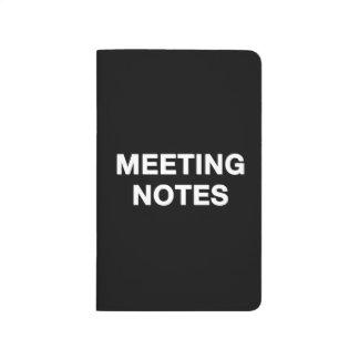 La reunión observa el cuaderno
