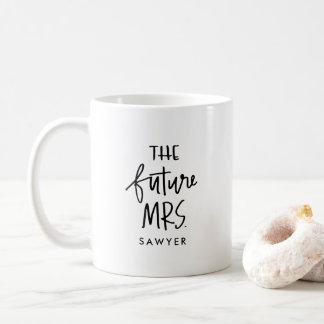 La señora futura taza de café indicada con letras