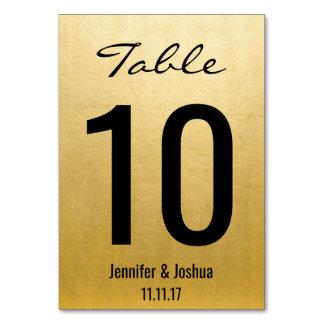 La tabla elegante del boda del oro numera
