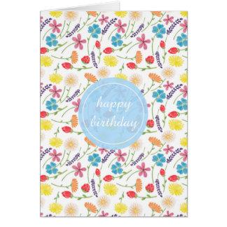 La tarjeta de cumpleaños colorida de las flores