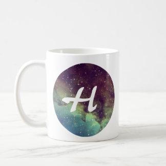 """La taza conocida de la letra """"H"""" con la impresión"""