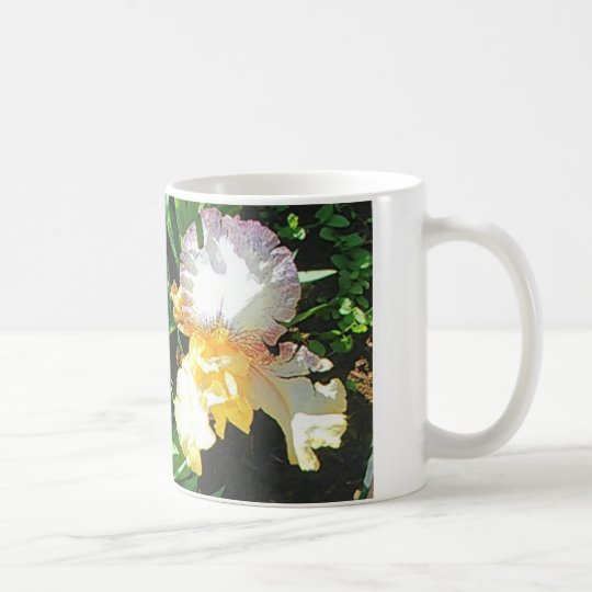 La taza de café del iris amarillo