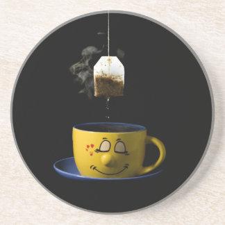 La taza de té bebe el práctico de costa posavasos manualidades