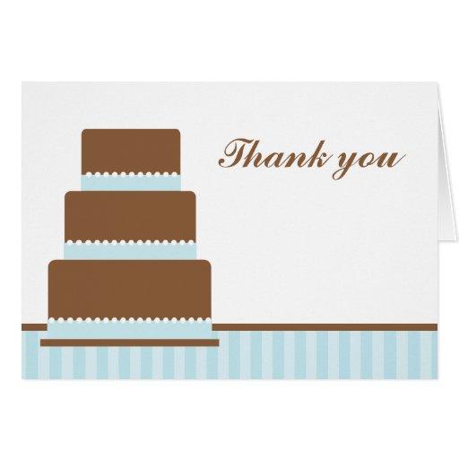 La torta de cumpleaños azul le agradece las notas tarjeta
