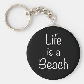 La vida es un llavero de la impresión de la playa