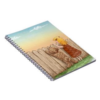 Labradoodle y chica cuaderno