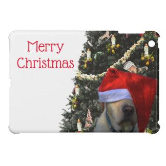 Labrador amarillo de oro en navidad del gorra de