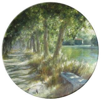 Landscape with a path close to the river póster plato de porcelana