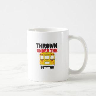 Lanzado debajo del autobús taza de café