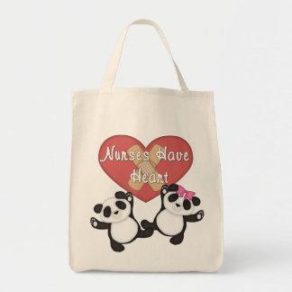 Las enfermeras tienen corazón bolsa tela para la compra