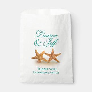 Las estrellas de mar se juntan en el boda de playa bolsa de papel