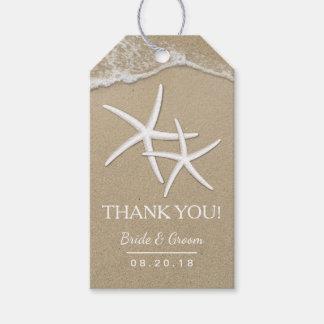 Las estrellas de mar y las ondas del boda de playa etiquetas para regalos