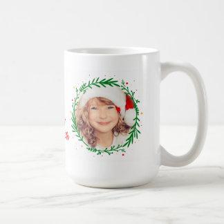 Las Felices Navidad enrruellan la taza moderna