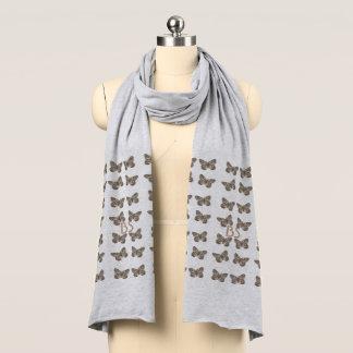 Las mariposas elegantes del oro añaden la bufanda