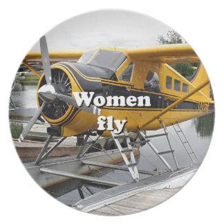 Las mujeres vuelan: avión del flotador, capilla plato