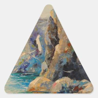 Las rocas en la orilla pegatina triangular