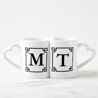 Las tazas del par del monograma