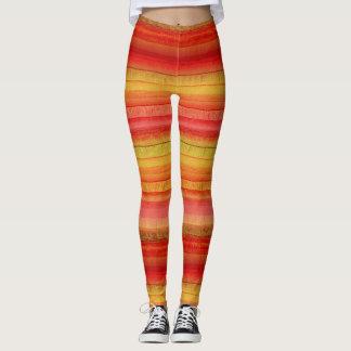 Leggings Rayas coloridas amarillas y polainas anaranjadas