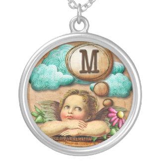 letra inicial M de la querube del ángel de las ilu Grimpola