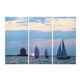 Lienzo 3 naves en la puesta del sol envolvieron la