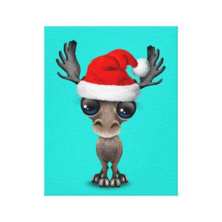 Lienzo Alces del bebé que llevan un gorra de Santa