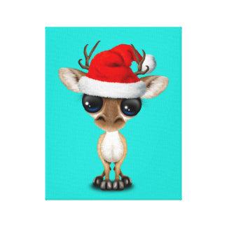 Lienzo Ciervos del bebé que llevan un gorra de Santa