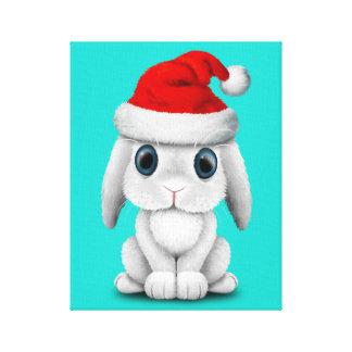 Lienzo Conejito blanco del bebé que lleva un gorra de