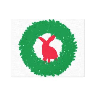 Lienzo Conejo de conejito del navidad en una guirnalda