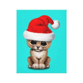 Lienzo León Cub lindo que lleva un gorra de Santa
