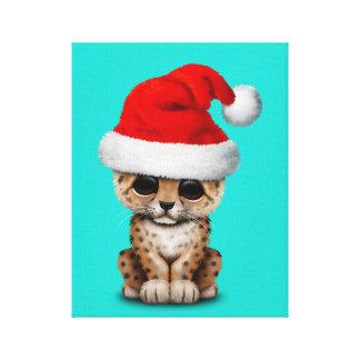 Lienzo Leopardo lindo Cub que lleva un gorra de Santa