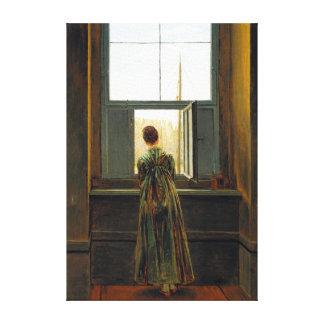 Lienzo Mujer de Caspar David Friedrich en una ventana