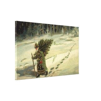 Lienzo Navidad del vintage, Papá Noel que lleva un árbol