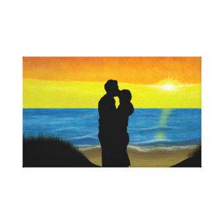 Lienzo Pareja a la playa a la caída del sol