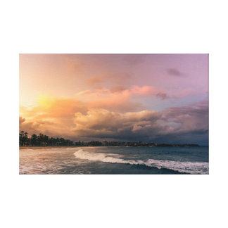 Lienzo Puesta del sol imponente sobre la playa de