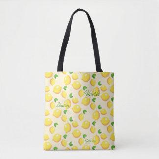 Limones frescos amarillos, la bolsa de asas del