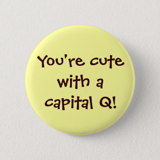 Lindo con un botón del capital Q