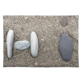 Lindo simple con playas de la roca de la arena del salvamanteles