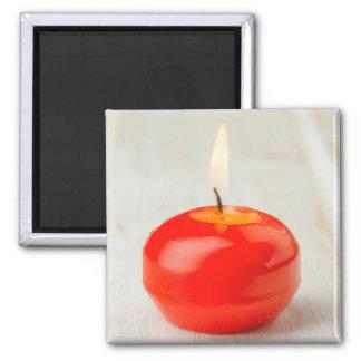 Lit rojo de la vela del navidad imán