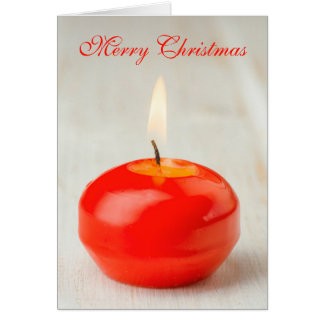 Lit rojo de la vela del navidad tarjeta de felicitación