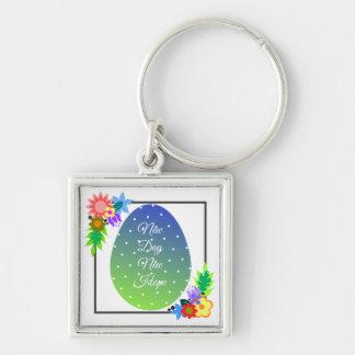 Llavero Huevo lindo del lunar con la guirnalda floral