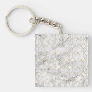 Llavero Mármol blanco con el modelo del cubo del oro