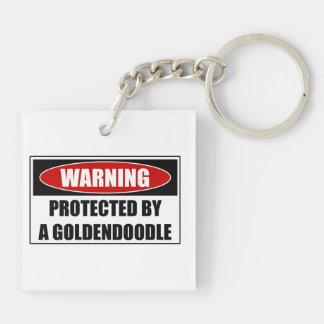 Llavero Protegido por un Goldendoodle