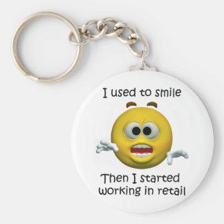 Llavero Sonreía humor al por menor del empleado