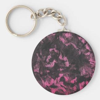 Llavero Tinta negra en fondo rosado