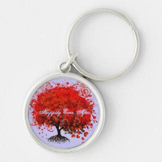 Llaveros rojos del boda del árbol