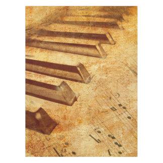 Llaves del piano de la hoja de música del Grunge Mantel